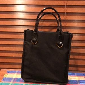 Black fabric and patent tote.